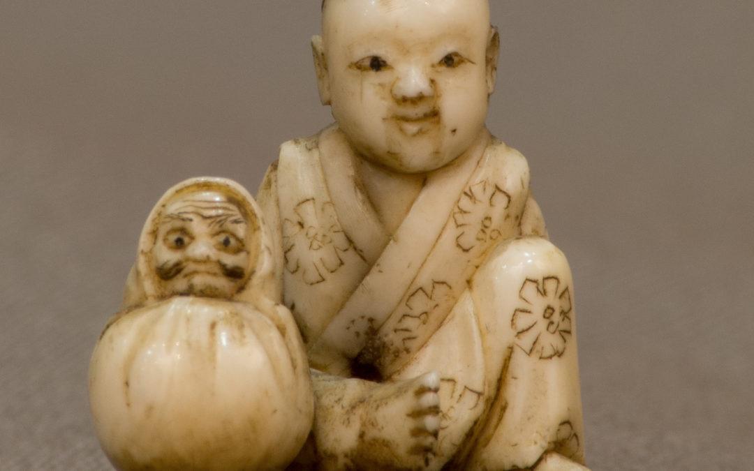 Enfant au Daruma, netsuke